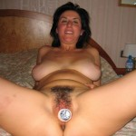 Milf opens her shaved Pussy